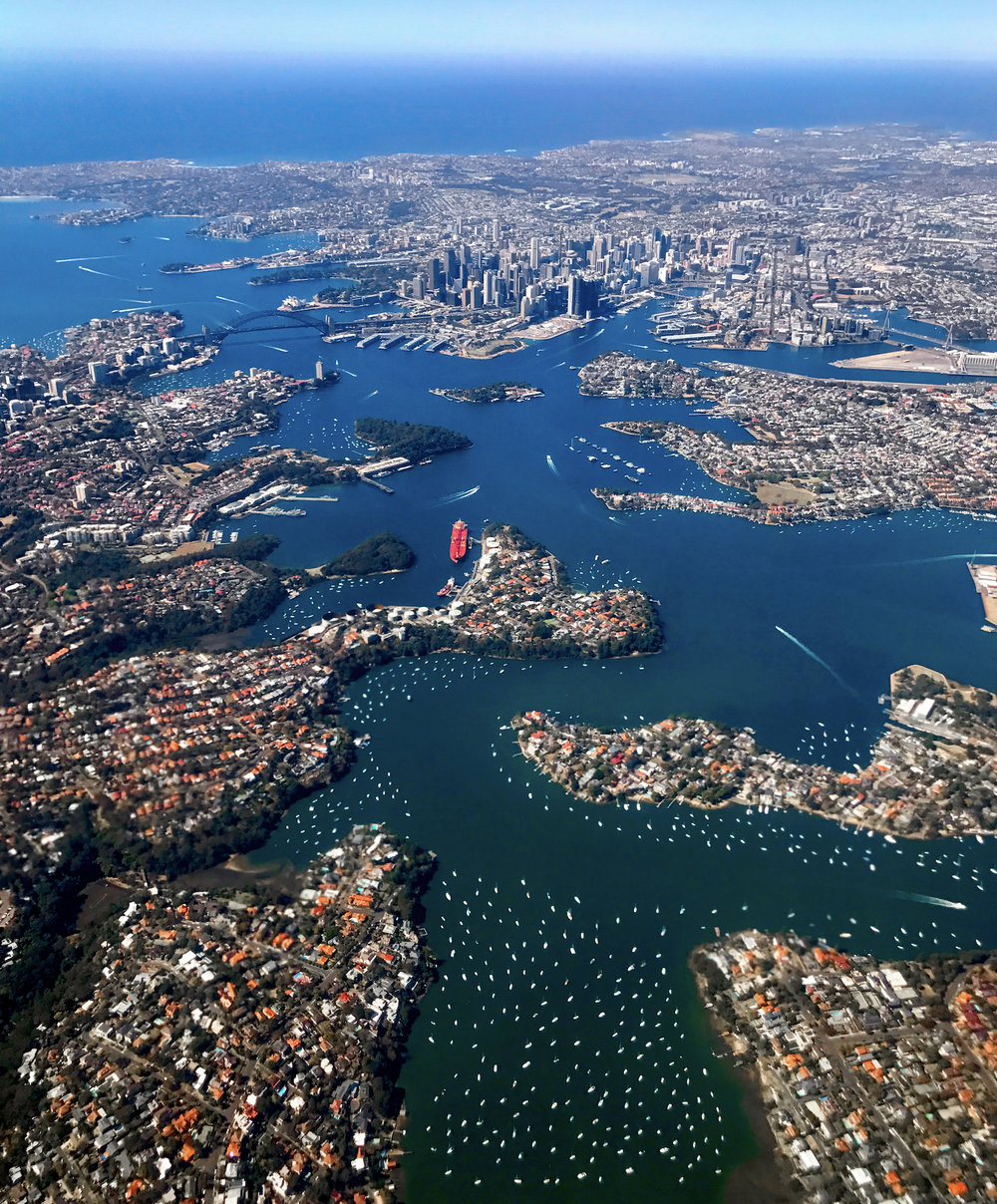 Check out this stunning view of Sydney, Australia. The city is the most populous on the continent with more than five million residents. The geography of the city - located on the Tasman city and built around numerous harbors and inlets - is beautifully captured in this photo.  33°51′54″S 151°12′34″E  Image shot from an airplane by Tiarne Hawkins