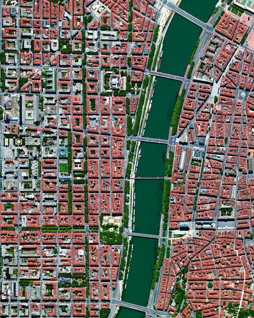 The city of Lyon is the third largest city in France and is situated at the convergence of the Rhône and Saône Rivers. A section of the city, split by the Rhône, is seen in this Overview. Lyon is often recognized as the birthplace of cinema - pioneered by the Lumière brothers here in 1895 - as well as a major culinary center.  45.7626909, 4.8390297