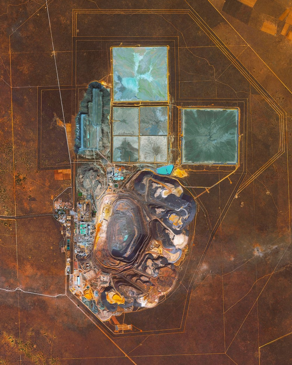 The Jwaneng Diamond Mine in Botswana is the richest diamond mine in the world, with an annual output of approximately 15.6 million carats. Mine richness takes into account the rate of diamond extraction combined with the quality of the diamonds that are mined (sale price per weight). To extract the diamonds, the facility produces 9.3 million tonnes of ore and an additional 37 million tonnes of waste rock per year. –24.523050°, 24.699750°