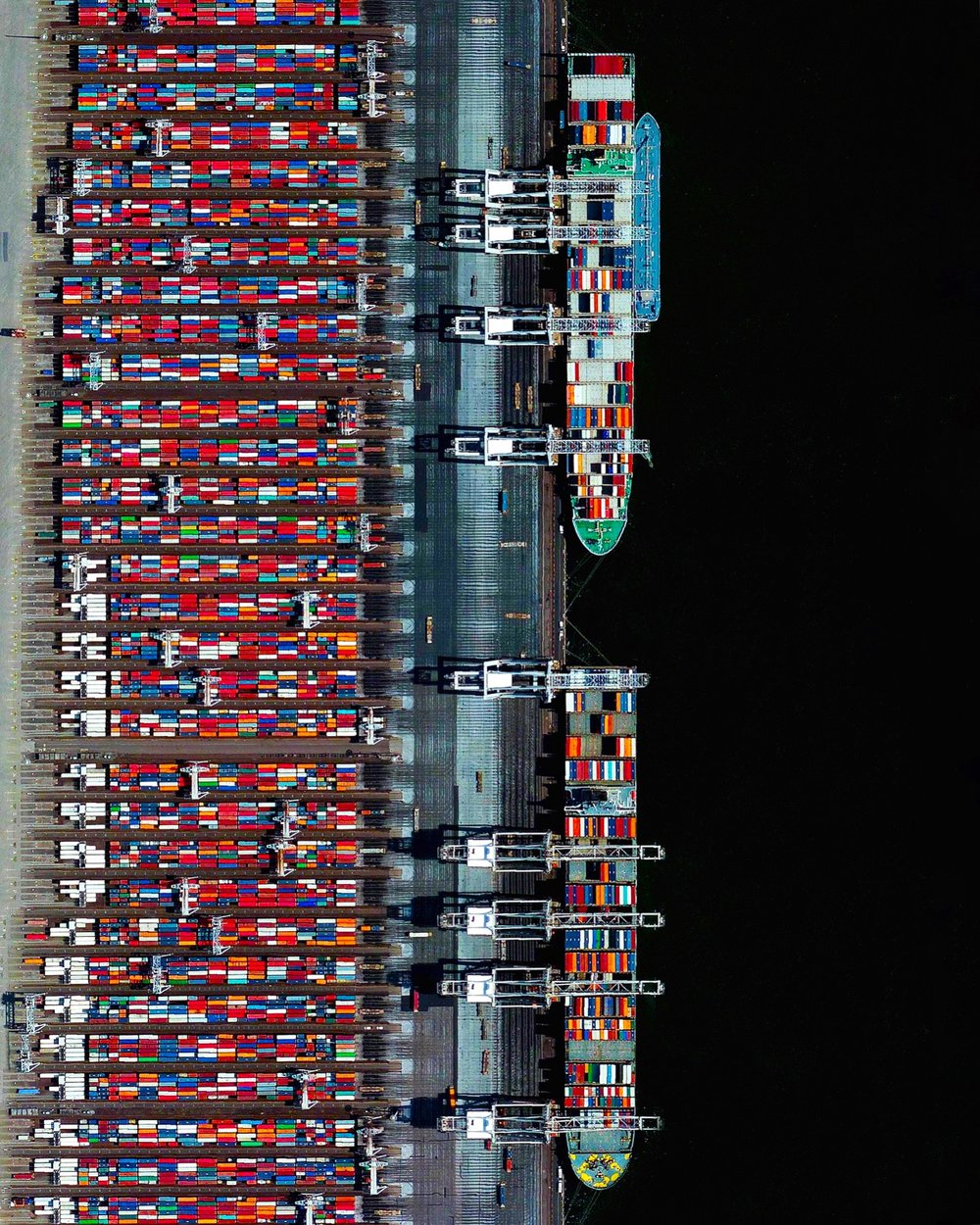 Shipping containers are seen at the Port of Rotterdam in the Netherlands. From 1962 until 2002, the facility was the world's busiest port, but was overtaken first Singapore and later Shanghai. In 2015, Rotterdam ranked as the world's sixth-largest port in terms of annual cargo tonnage.  51.952790 °, 4.053669°  Source imagery: DigitalGlobe