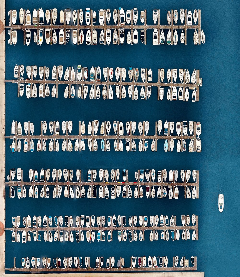 Sailboats are docked at DuSable Harbor in Chicago, Illinois, USA. The facility is located on Lake Michigan in the heart of the city's downtown area and contains 420 slips for boats between 30 to 60 feet in length.  41.8798146, -87.618203  Source imagery: Nearmap
