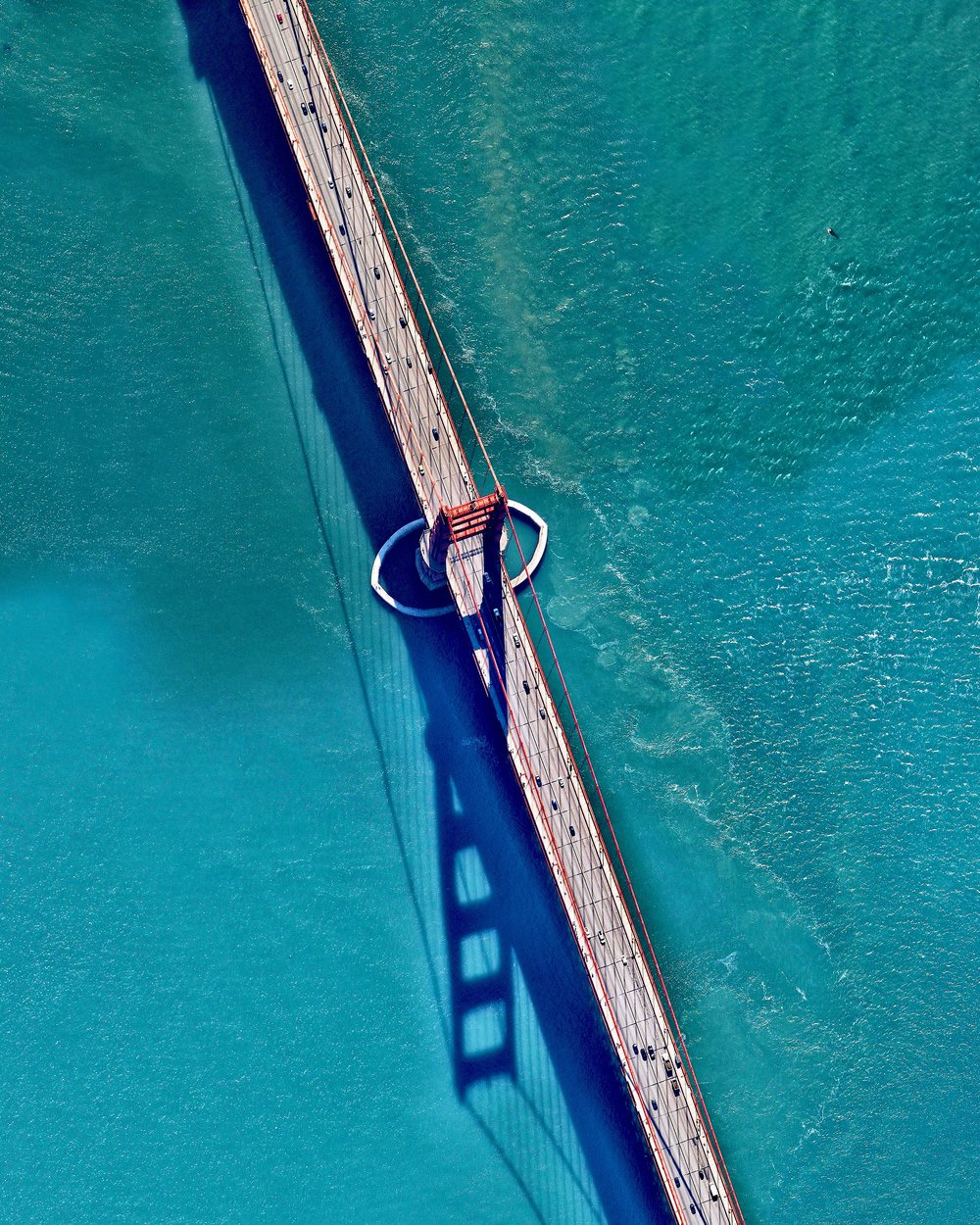 "The Golden Gate Bridge is a 1.7 mile long suspension bridge in San Francisco, California that spans the Golden Gate Strait, the mile-wide channel between San Francisco Bay and the Pacific Ocean. The bridge's signature color, known as ""international orange"", was selected to complement its natural surroundings and enhance its visibility in fog.  Source imagery: Nearmap"
