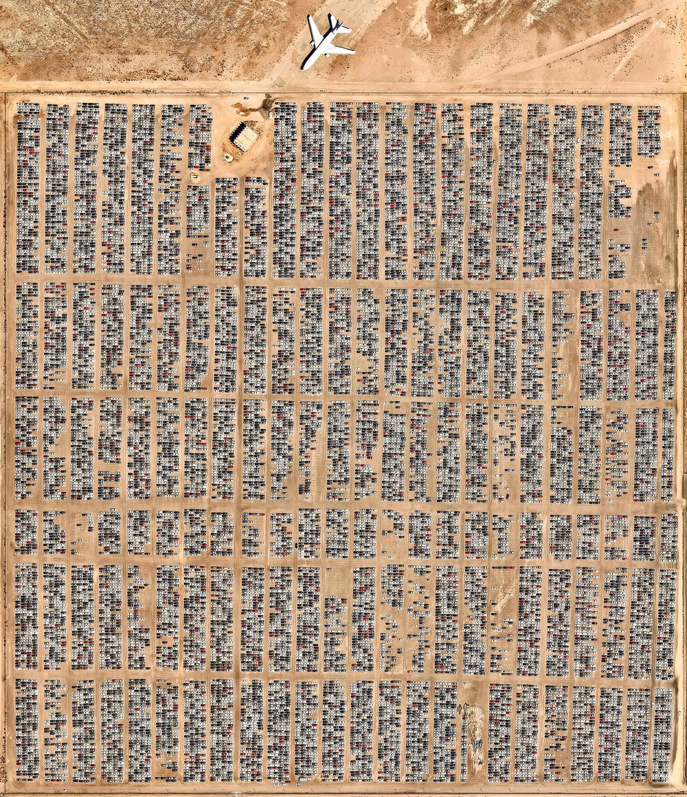 Thousands of diesel-powered Volkswagens are parked at Southern California Logistics Airport in Victorville, California. While this facility is known for its airplane graveyard, Volkswagen has leased enough land here to park 21,0000 vehicles. Following its emission scandal in 2015, the company gave customers the option to sell their cars back to the company. More than 340,000 customers have elected to return their vehicles so far.  34°35′51″N 117°22′59″W  Source imagery: Nearmap