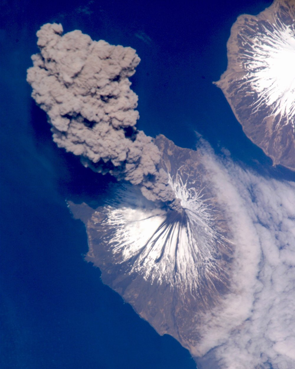 "Check out this incredible shot, which shows the eruption of Cleveland Volcano in Alaska's Aleutian Islands. It was captured in May 2006 by an Expedition 13 crew member aboard the International Space Station. Mount Cleveland is one of the most active volcanoes in the Aleutian Arc, having erupted an estimated 22 times in the last 230 years.  52°49'18.1""N 169°56'48.0""W  Image courtesy of: NASA"