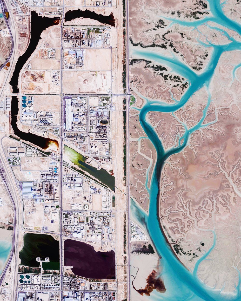 "The Bandar Imam Khomeini petrochemical complex is Iran's largest supplier of petrochemicals for export, generating millions of tons of petroleum-based products every year. Located in Iran's southwestern Khuzestan Province, the complex is seen in this Overview adjacent to Musa Bay, a shallow estuary that empties into the Persian Gulf.  30°28'18.0""N, 49°05'58.0""E  Source imagery: DigitalGlobe"