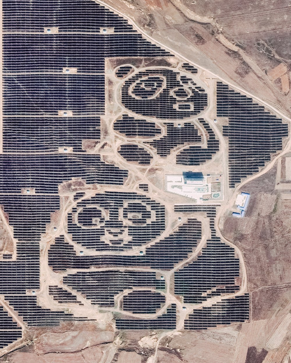 "Two pandas are formed by solar panels at the Panda Green Energy power plant in Datong, Shanxi Province, northern China. Built in cooperation with the United Nations Development Program, this solar farm covers roughly 1,500 acres and includes an education center that teaches children about sustainable and renewable energy.  39°58'23.6""N, 113°29'03.7""E  Source imagery: DigitalGlobe"