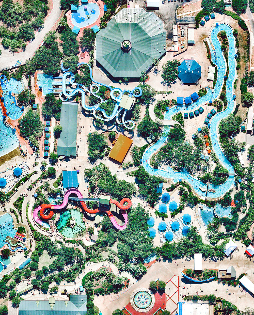 "Check out this Overview of Aquatica, a water park in San Antonio, Texas. Constructed in 2012, Aquatica boasts several water slides, pools, a 42,000-square-foot beach area, an aviary, and its signature ""Stingray Falls,"" a family raft ride that runs through an underground grotto full of stingrays and tropical fish.  29°27'30.3""N, 98°41'53.3""W  Source imagery: Nearmap"