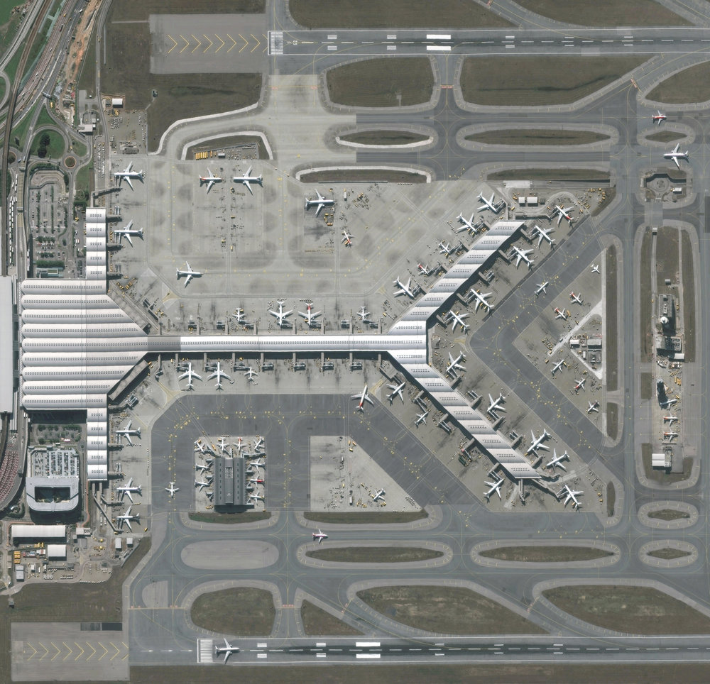 "Hong Kong International Airport is located on Chek Lap Kok, an island in Hong Kong's western waters. It is the world's busiest cargo gateway and also one of the busiest passenger airports on Earth, handling upwards of 65 million passengers a year. Terminal 1, seen here, measures 570,000 square meters (6.1 million square feet), making it the third largest passenger terminal in the world.  22°18'48.8""N, 113°55'49.8""E  Source imagery:  DigitalGlobe"