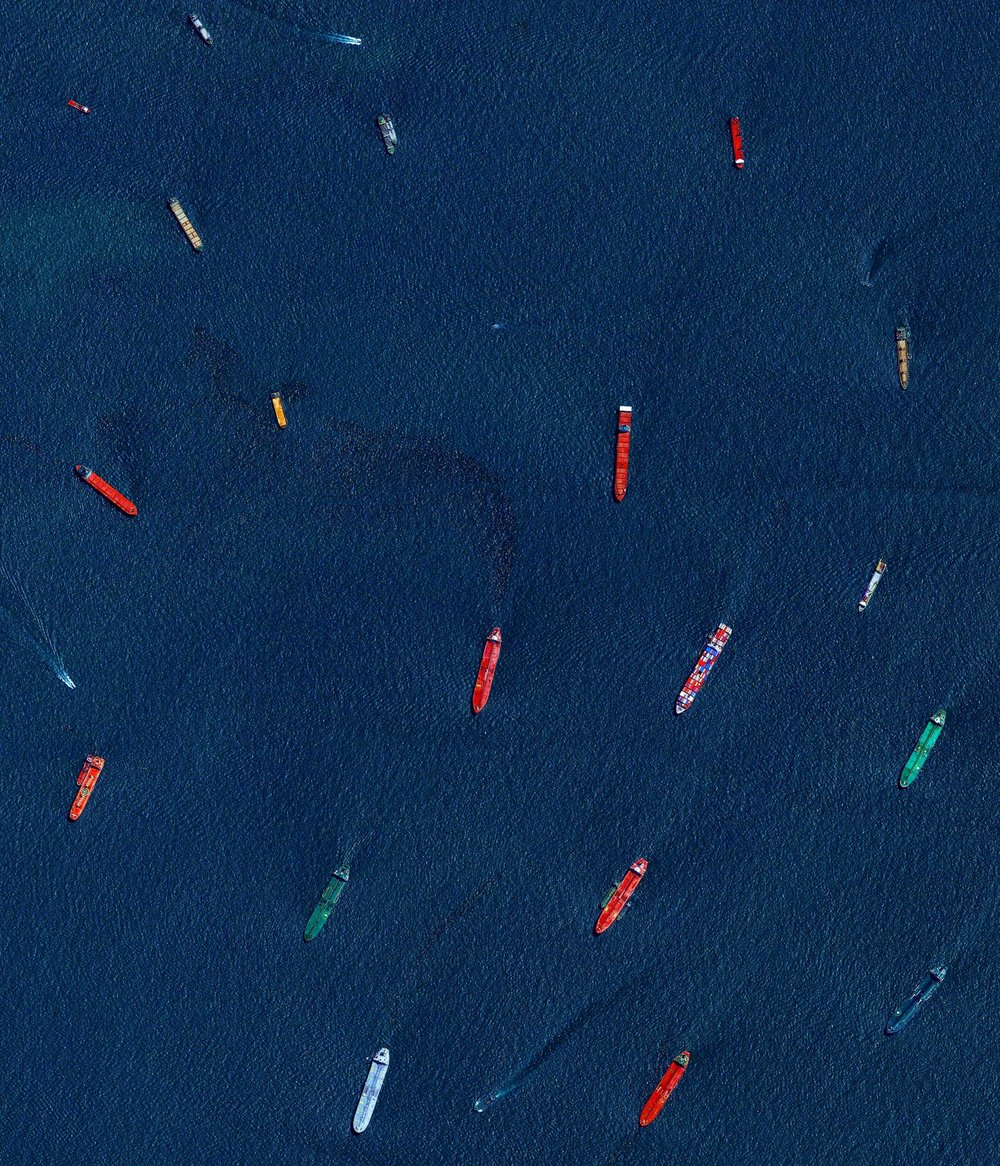 "Check out this Overview, which captures cargo ships and tankers — some weighing up to 300,000 tons — outside of the entry to the Port of Singapore. The facility is the world's second-busiest port in terms of total tonnage, shipping a fifth of the world's cargo containers and half of the world's annual supply of crude oil.  1°15'21.4""N, 103°46'51.6""E  Source imagery: DigitalGlobe"