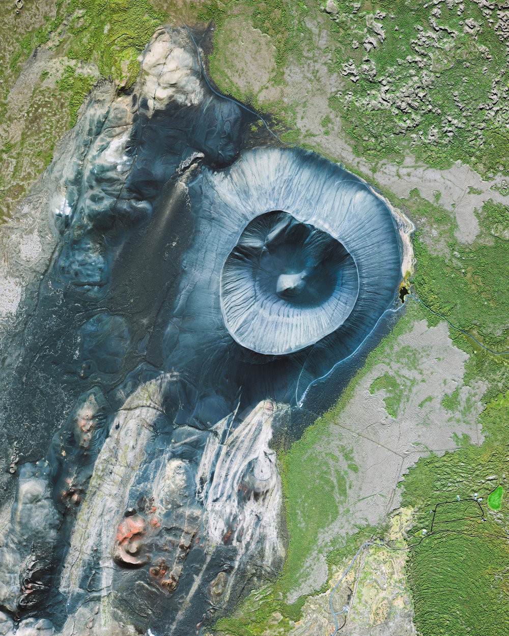 """Hverfjall is a tephra cone, or tuff ring, volcano located near the eastern shore of Lake Myvatn in northern Iceland. It erupted in 2500 BP, leaving behind a massive crater more than half a mile (1 km) in diameter. Hverfjall is just 1,300 feet (396 m) high, allowing tourists and hikers to scale its slopes and walk along the crater's rim.  65°36'19.3""""N, 16°52'21.1""""W  Source imagery: DigitalGlobe"""