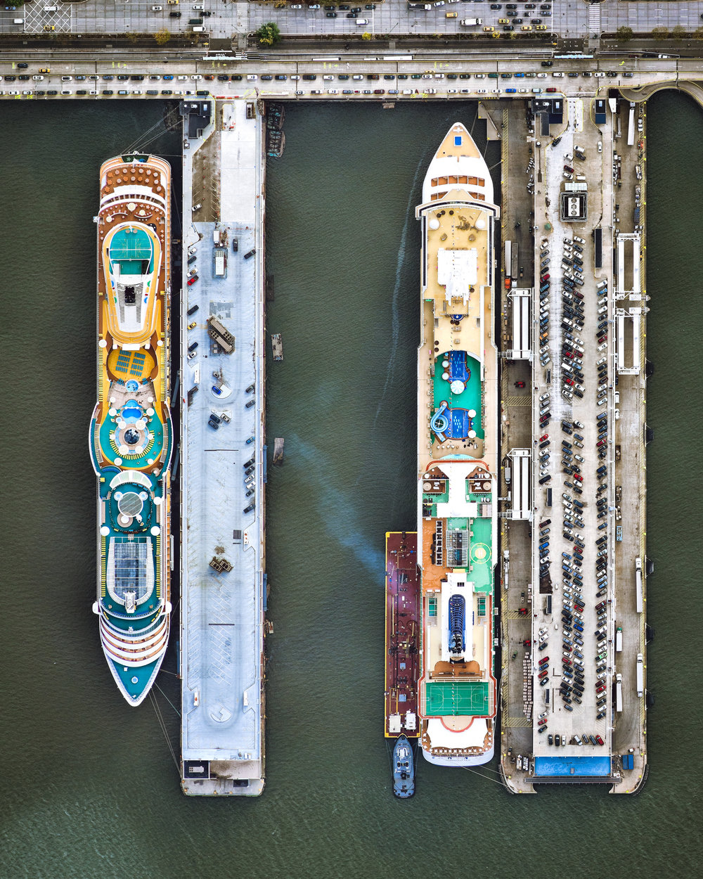 """Piers 88 and 90 make up the Manhattan Cruise Terminal, a gateway for ocean-going passenger ships in the Hell's Kitchen neighborhood of New York City. Both piers are 1,100 feet (340 m) long and 400 feet (120 m) apart, and together they handle more than 1 million passengers per year.  40°46'06.9""""N, 73°59'50.5""""W  Source imagery: Nearmap"""