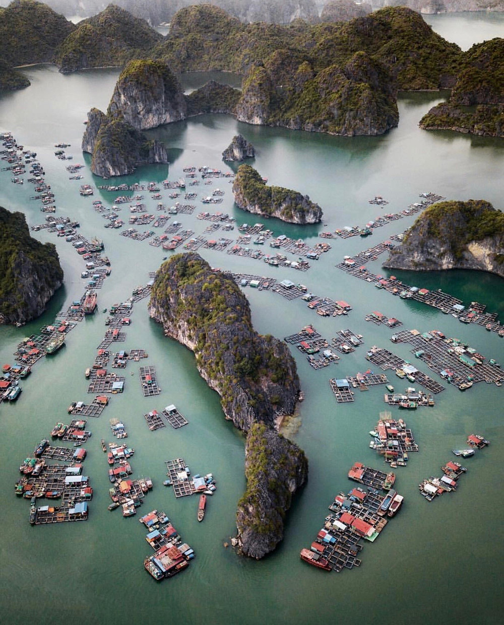 "Check out this week's ""Drone Sunday"" post from From Where I Drone, which shows the Cát Bà Archipelago in northern Vietnam. It is made up of 367 islands that span 100 square miles (260 sq. km) in the southeastern edge of Lan Ha Bay. The largest island — also called Cát Bà — has roughly 13,000 inhabitants, with an additional 4,000 people living on floating fishing villages off the coast.  20°44'12.0""N, 107°03'44.0""E  Source imagery: @rcrdb"