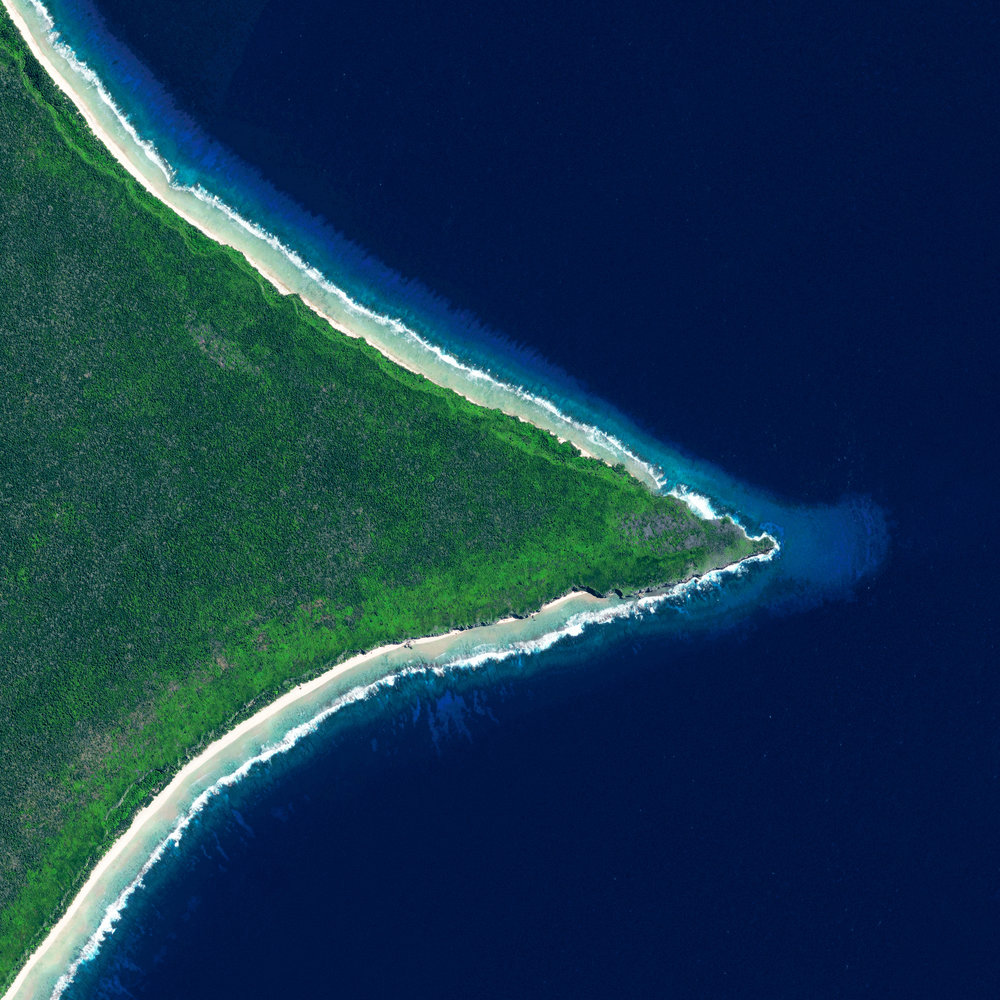 "Henderson Island is a 14.4-square-mile, uninhabited landmass in the South Pacific Ocean. Recent studies have shown that this area has a higher density of plastic wash up on its shores than any other place on the globe. It is estimated that the island's shores now contain 37.7 million items of debris, weighing a total of 17.6 tons.  24°20'06.6""S, 128°18'37.6""W  Source imagery: DigitalGlobe"