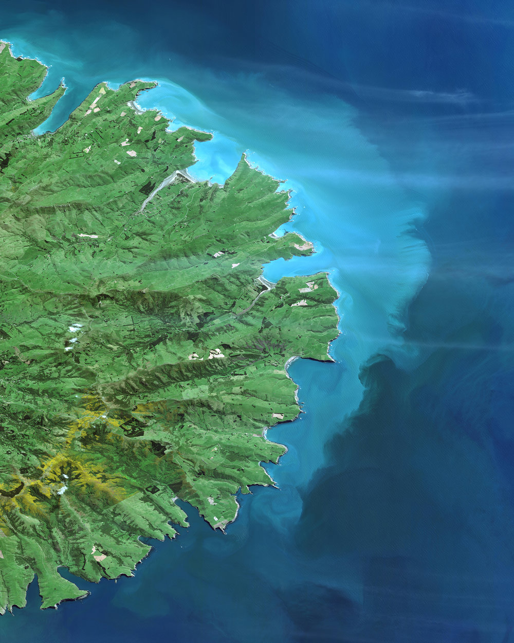 "Check out this amazing Overview of the Banks Peninsula, which juts off the east coast of New Zealand's South Island. The landmass, which is volcanic in origin, has an area of roughly 440 square miles (1,150 sq. km) and encompasses two large harbors and many small bays and coves. It is believed that forests once covered 98% of the Banks Peninsula, yet — as the result of deforestation — less than 2% of the native forest cover remains today.  43°45'00.0""S, 172°49'58.8""E  Source imagery: DigitalGlobe"