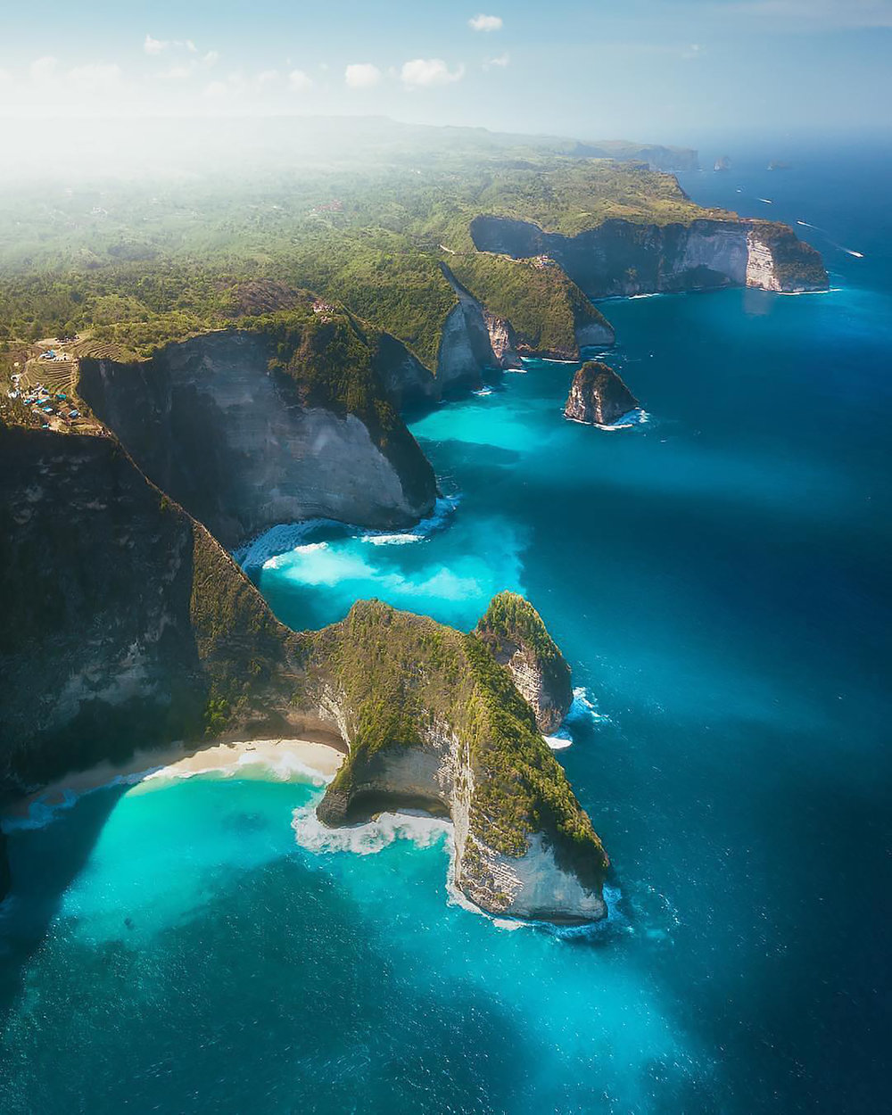 """Check out this breathtaking shot we found on @paradise, which shows the shoreline of Nusa Penida, an island located off the southeastern coast of Bali, Indonesia. Nusa Penida, along with the neighboring Lembongan and Ceningan islands, serves as an unofficial bird sanctuary for numbers of endangered Balinese and Indonesian bird species, most notably the Bali Starlin.  8°44'00.0""""S, 115°32'00.0""""E  Source imagery: Karl 'Shakur' Ndieli"""