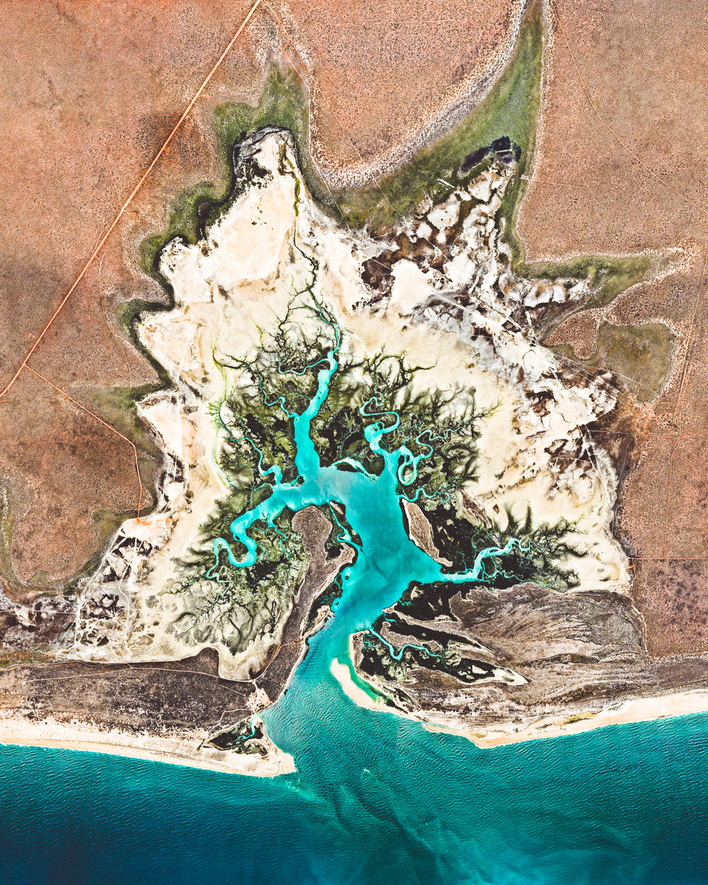 """Willie Creek is a protected tidal estuary roughly 10.5 miles (17 km) north of Broome, Western Australia. The creek's calm, nutrient-rich waters make it an ideal habitat for the Pinctada maxima oyster, which produces world-renowned pearls.  17°45'45.2""""S, 122°14'14.2""""E  Source imagery: Nearmap"""