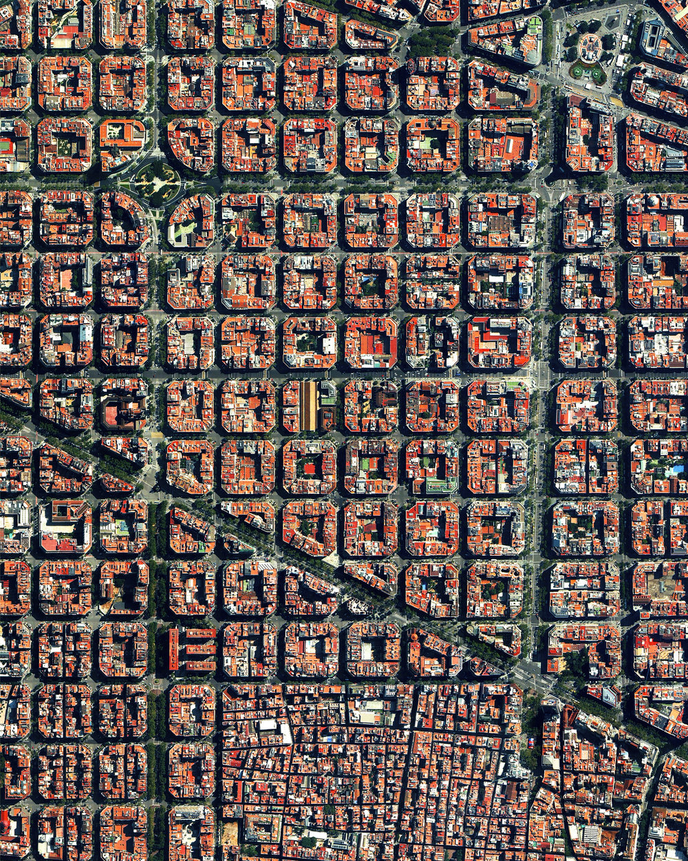 The Eixample district in Barcelona, Spain, is characterized by its strict grid pattern and apartments with communal courtyards. This thoughtful and visionary design was the work of Ildefons Cerdà. His plan features broad streets that widen at octagonal intersections to create greater visibility with increased sunlight, better ventilation, and more space for short-term parking. This image is on display right now at our exhibition at theprintspace in Shoreditch, London. We're also selling prints of it, and – thanks to theprintspace – we are able to offer FREE shipping throughout Europe during the exhibition, which ends November 26th! Visit  dailyoverview.com/printshop/country  to take advantage of this exclusive offer.  41°23′27′′N, 2°09′47′′E  Source imagery: DigitalGlobe