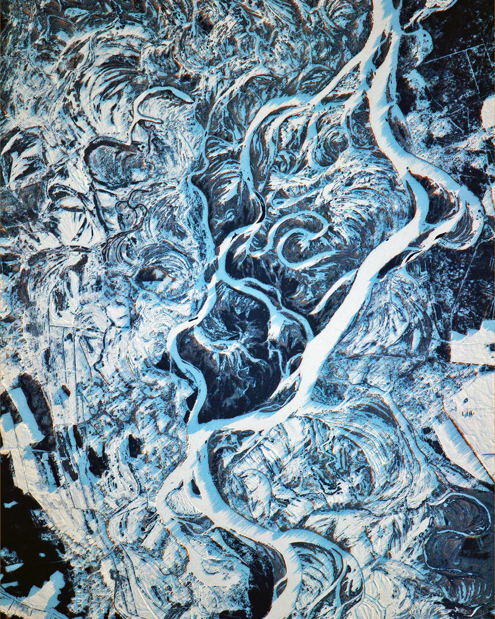 """Swirling snow drifts accent the terrain surrounding the Dnieper River, which flows for roughly 1,400 miles (2,200 km) from Russia to the Black Sea. The Dnieper is the longest river in the Ukraine and Belarus, and the fourth-longest river in Europe. This amazing image was captured by European Space Agency astronaut Thomas Pesquet while aboard the International Space Station in February 2017.  51°11'35.0""""N, 30°31'25.8""""E  Source imagery: NASA - National Aeronautics and Space Administration"""