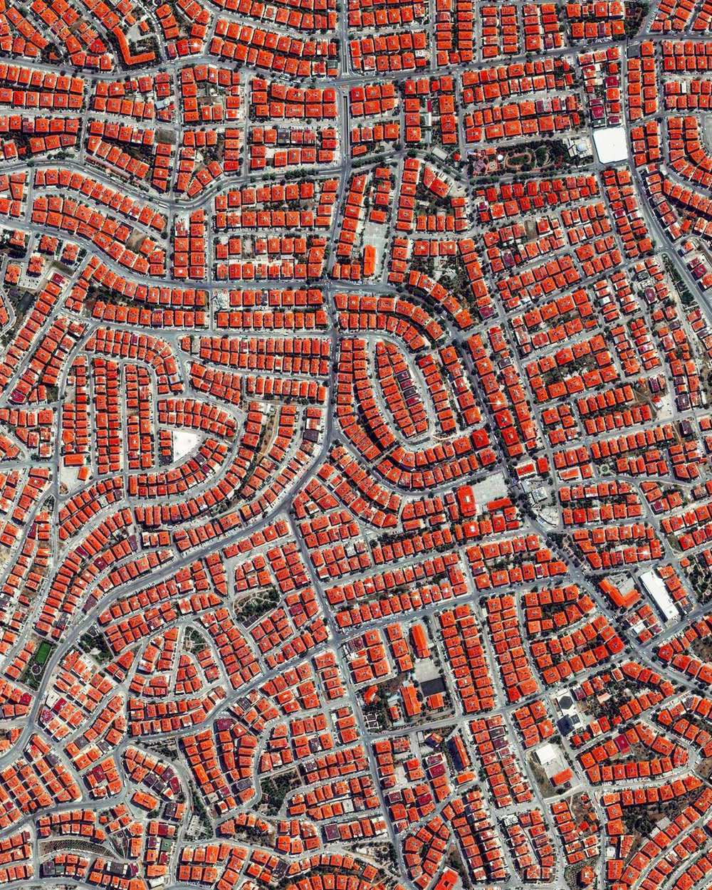 "A residential section of northern Ankara, Turkey, is shown in this Overview. Ankara is Turkey's capital and second largest city (after Istanbul), with more than 5.4 million residents. Historically known as Angora, the city lends its name to Angora wool, which is shorn from Angora rabbits and the long-haired Angora goat – the source of mohair.  39°59'15.0""N, 32°51'00.6""E  Source imagery: DigitalGlobe"