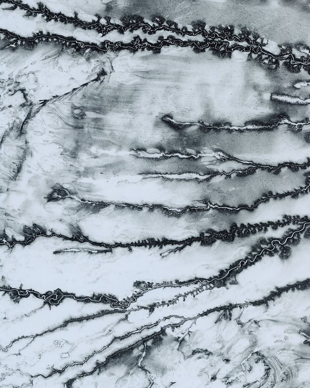 "Tributaries of the Moose River snake across snowy terrain near Moosonee, a town in northern Ontario, Canada. This area is part of the Hudson Plains Ecozone, a sparsely populated subarctic region extending from the western coast of Quebec to the coast of Manitoba. The ecozone contains the largest continuous wetland in the world, including the Moose River's 41,900-square-mile (108,500 sq. km) drainage basin.  51°04'26.3""N, 81°28'28.6""W  Source imagery: DigitalGlobe"