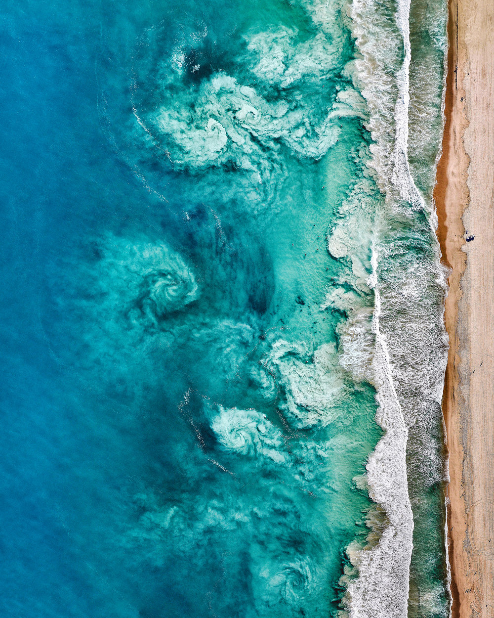 "With just hours left in 2018, we're sharing one more of our favorite Overviews created this year. This amazing shot shows swirling waves offshore Perth, Australia. The beaches in Perth are world-famous for their beautiful white sand and clear blue water. A sincere thank you to everyone who shared an image, purchased a print or a copy of ""Overview,"" or simply followed along in 2018. Happy New Year!  31°57'04.5""S, 115°45'14.9""E  Source imagery: Nearmap"