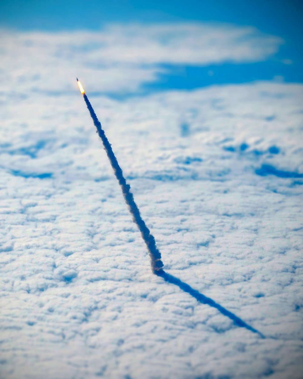 For your daily dose of perspective, here's a photograph of the space shuttle Endeavour, lifting through the clouds during its final launch in May 2011. The photograph was captured from a nearby NASA shuttle training aircraft.  Source imagery: NASA - National Aeronautics and Space Administration