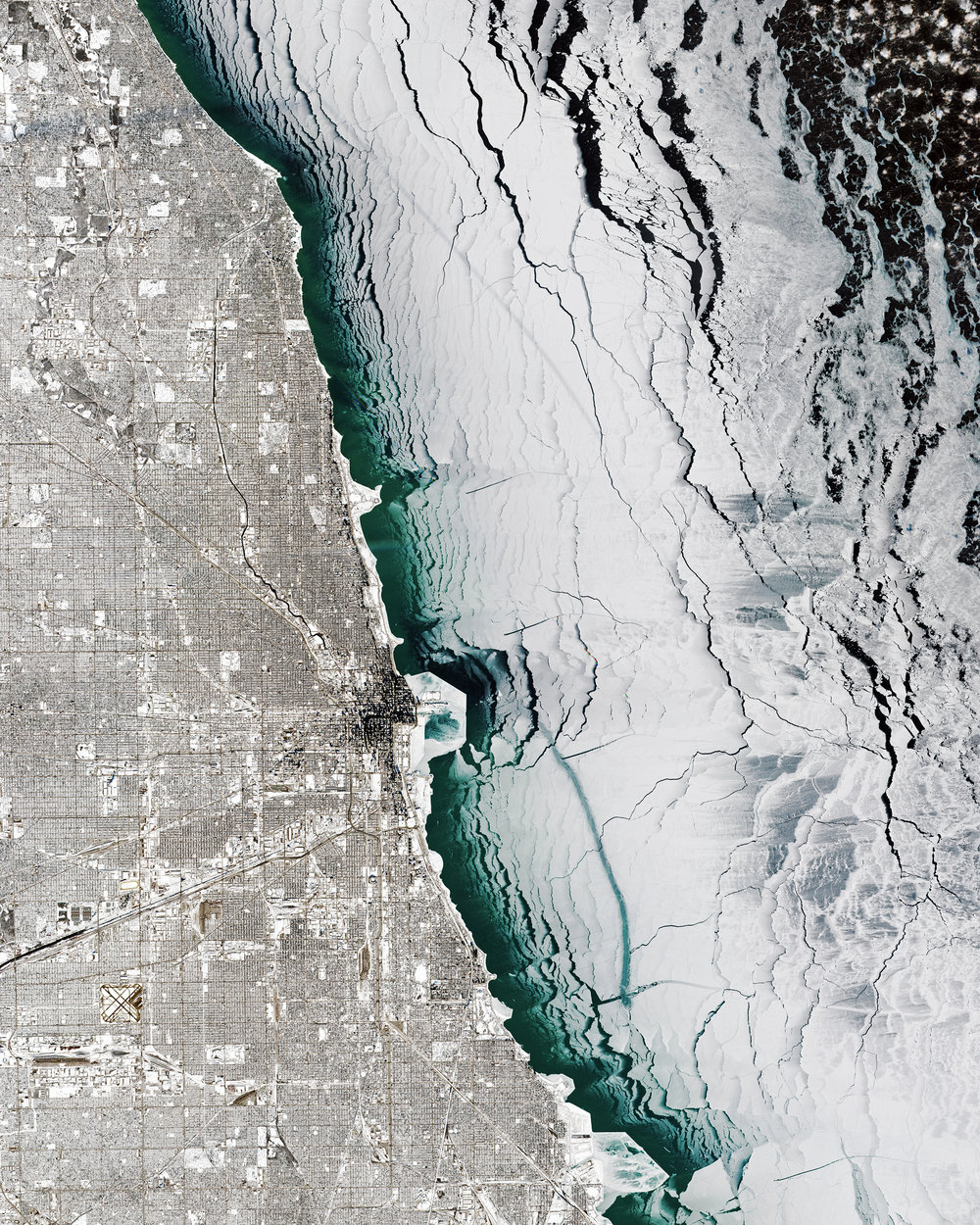"Check out this amazing Overview of Chicago, Illinois, and Lake Michigan during last week's polar vortex. Captured Thursday by the European Space Agency's Sentinel-2 satellite, it shows the entire city covered in snow with massive chunks of lake ice floating offshore. Chicago finished off the month of January with 13 consecutive days of snow and some of its coldest temperatures in more than three decades.  41°50'13.0""N, 87°41'05.0""W  Source imagery: ESA - European Space Agency via Descartes Labs"