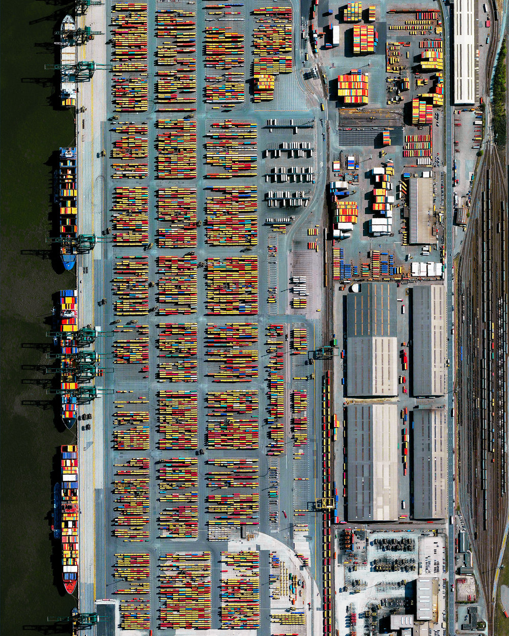 """The Port of Antwerp in Flanders, Belgium, is the second-largest seaport in Europe. Its inland location on a tidal estuary of the Scheldt River gives it an advantage over other North Sea ports, allowing its docks to connect to rail, road, river and canal transit systems. In 2018, nearly 14,600 seagoing vessels called at the Port of Antwerp with a combined transshipment of 235.2 million tonnes.  51°16'12.0""""N, 4°20'12.0""""E  Source imagery: DigitalGlobe"""