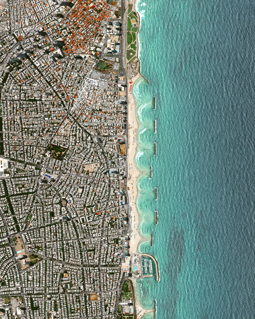 """Located on the coast of the Mediterranean Sea, Tel Aviv is the second most populous city in Israel and is recognized as the country's financial center and a major technology hub. With a city plan dating back to the 1920's, Tel Aviv was constructed with a hierarchical system of streets laid out in a grid and large blocks consisting of small-scale dwellings that surround central, open spaces.  32°04'42.0""""N, 34°46'08.4""""E  Source imagery: DigitalGlobe"""
