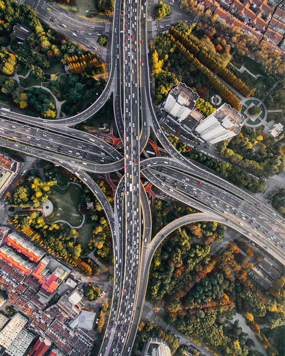 """The Puxi Viaduct in Shanghai, China, is one of the largest and busiest interchanges in the world. Its five levels of bridges connect two of the city's busiest highways, Nanbei Road and Yan'an Road, allowing thousands of vehicles to pass through every hour.  31°13'34.6""""N, 121°27'52.5""""E  Source imagery: Denys Nevozhai"""