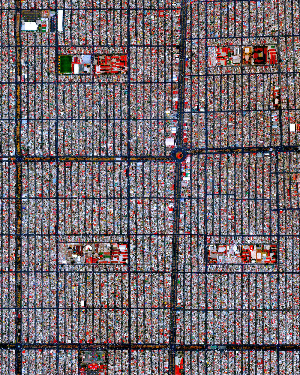 """This Overview captures the tightly gridded streets of Nezahualcóyotl, a municipality of Mexico City. With a population of more than one million, this area is home to many of the capital's citizens who have migrated there from other parts of the country. The Greater Mexico City area has roughly 21 million residents, making it the largest metropolitan area in North America.  19°24'26.8""""N, 99°01'40.2""""W  Source imagery: DigitalGlobe"""