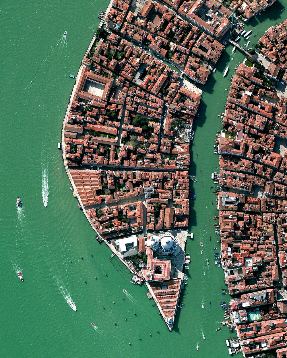 """This Overview shows part of the Dorsoduro sestiere in Venice, Italy. A sestiere — which comes from the Italian """"sesto,"""" meaning sixth — is a subdivision of an Italian town or city divided into six districts. Dorsoduro is Venice's university district and is filled with bars, restaurants, indie shops, vintage fashion boutiques and art galleries, such as the Peggy Guggenheim Collection.  45°25'49.3""""N, 12°20'00.4""""E  Source imagery: DigitalGlobe"""