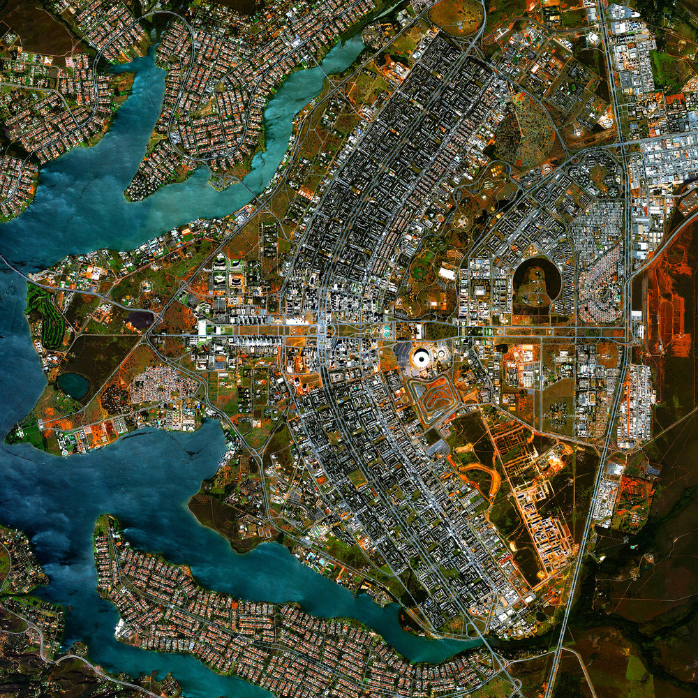 """This Overview captures the urban plan of Brasilia. The city was founded on April 21, 1960, in order to move the capital from Rio de Janeiro to a more central location within Brazil. The design — resembling an airplane from above — was developed by Lúcio Costa and prominently features the modernist buildings of the celebrated architect Oscar Niemeyer at its center.  15°47'38.0""""S 47°52'58.0""""W  Source imagery: DigitalGlobe"""