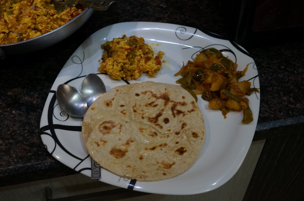 Chapati with stir-fry cottage cheese with capsicum & stir-fry potato with spices.
