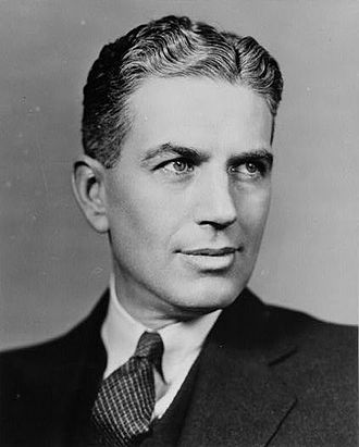 """Rexford Guy Tugwell (1891 – 1979) was an agricultural economist who became part of Franklin D. Roosevelt's first """"Brain Trust,"""" a group of Columbia University academics who helped develop policy recommendations leading up to the 1932 election. Tugwell subsequently served in FDR's administration for four years and was one of the chief intellectual contributors to his New Deal."""