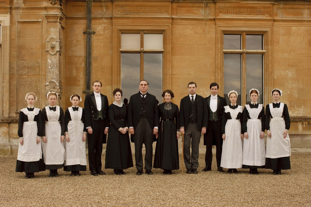 The Downton Abbey household staff ever attentive, Image via  express.co.uk