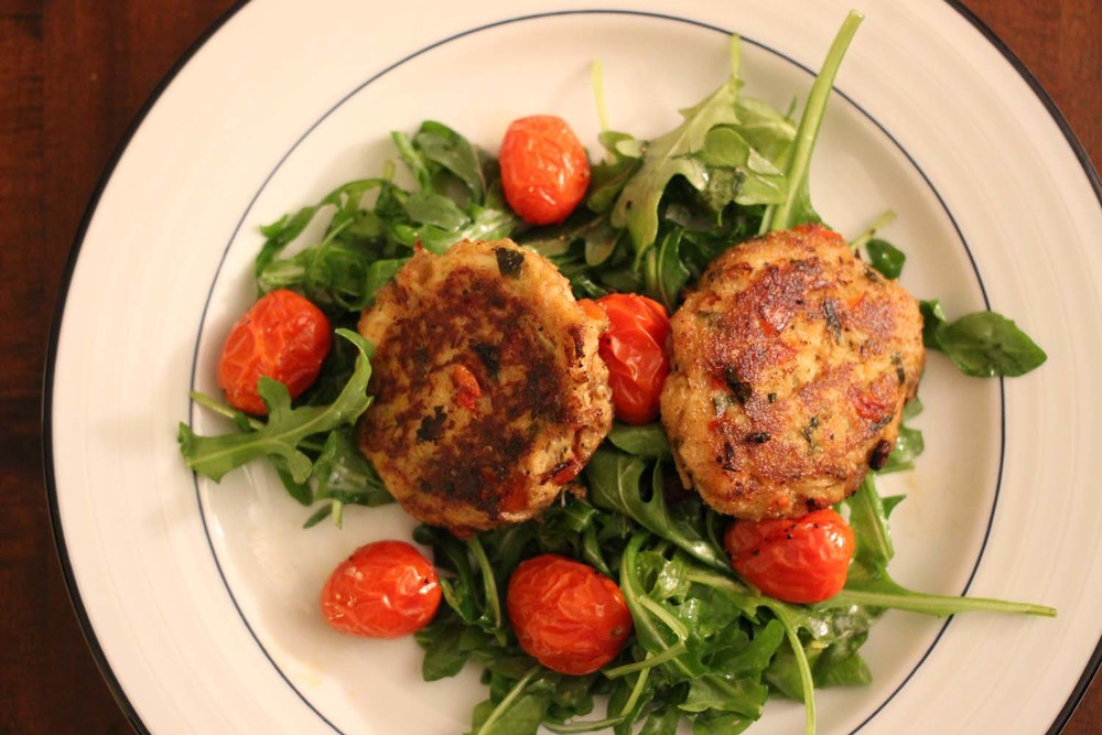 Crab Cakes and Arugula Salad with Roasted Tomatoes: Image: Laura Messersmith