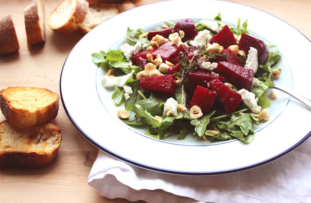 Roasted Beet Salad with Arugula, Goat Cheese and Hazelnuts | Image: Laura Messersmith