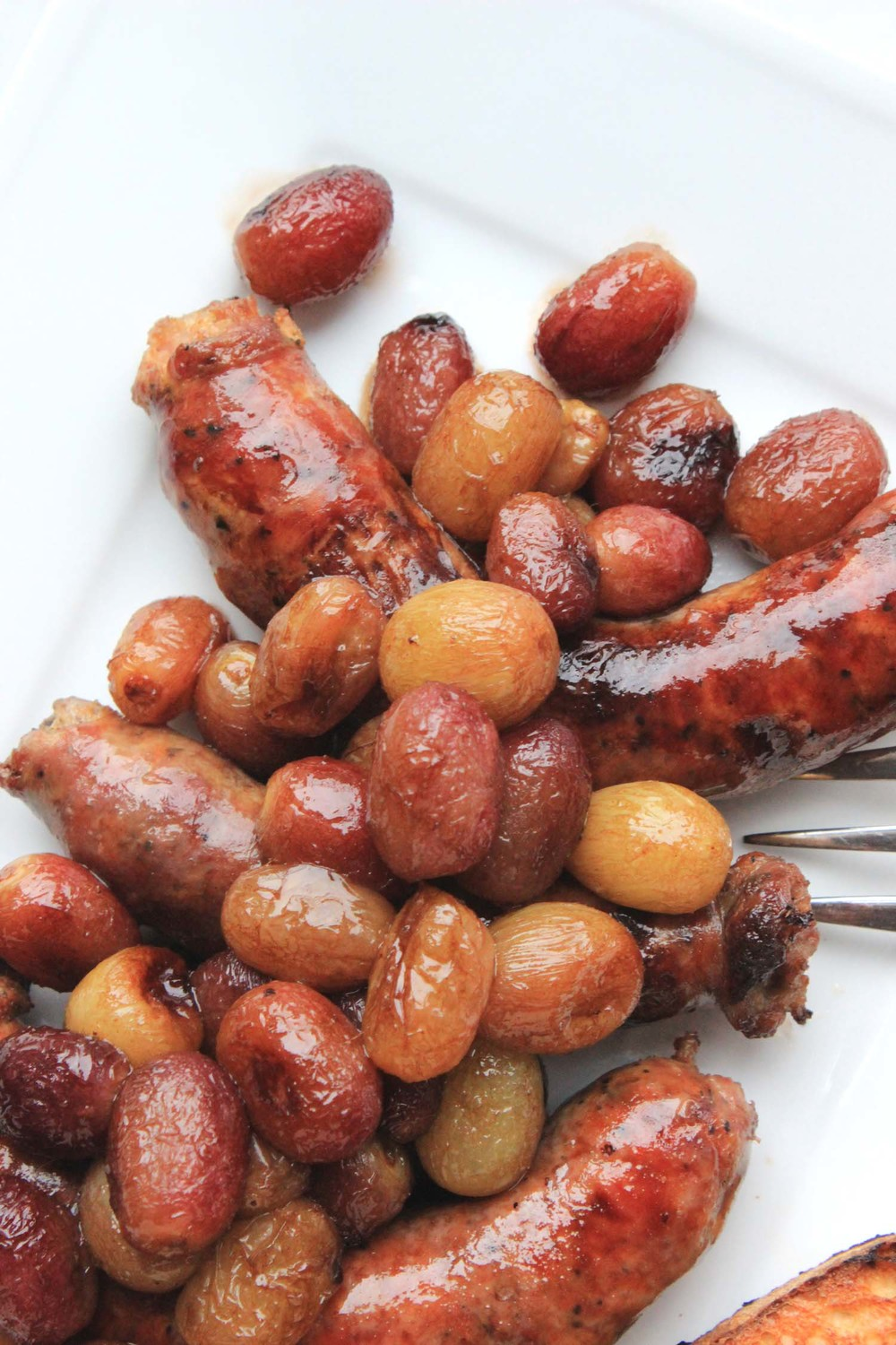 Roasted Sausages and Grapes   | Image:   Laura Messersmith