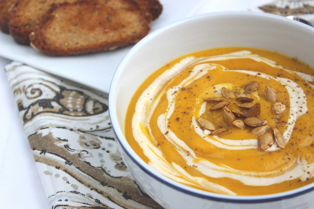 Curried Winter Squash Soup with Pumpkin Greek Yogurt Crème Fraîche | Image: Laura Messersmith