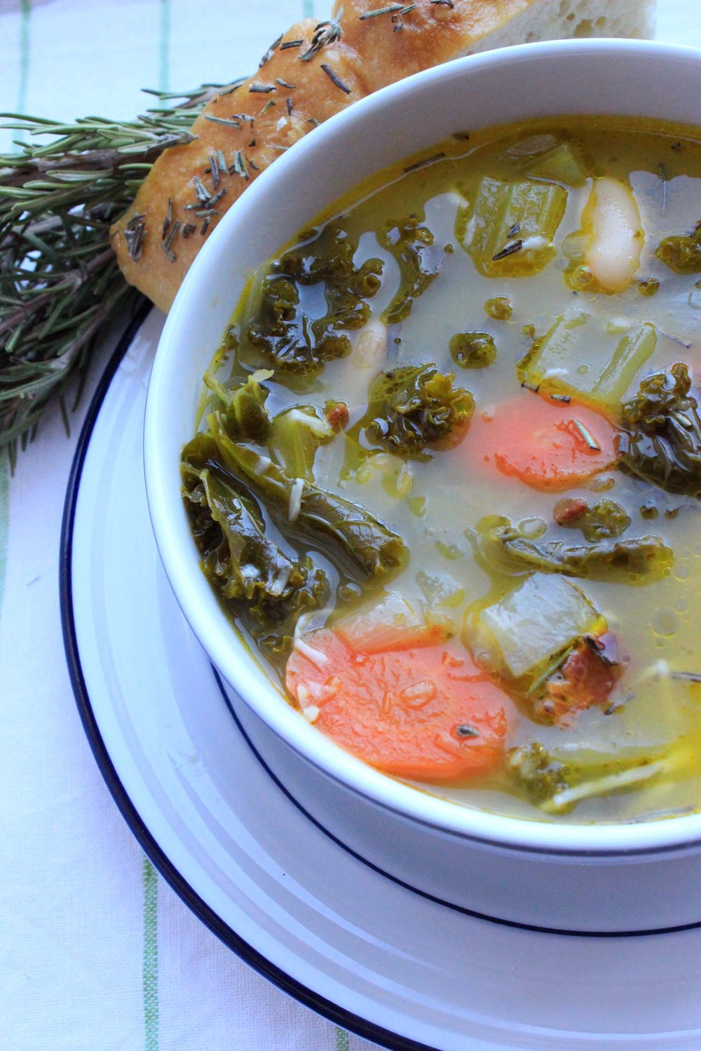 Tuscan White Bean & Kale Soup   | Image:   Laura Messersmith