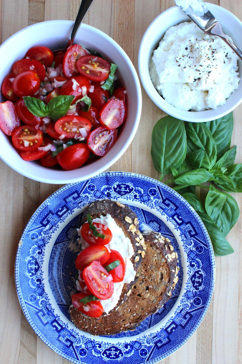 Tomato Crostini with Whipped Feta   | Image:   Laura Messersmith