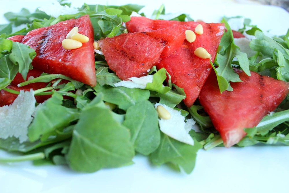 Grilled Watermelon Salad with Arugula & Pine nuts   | Image:   Laura Messersmith
