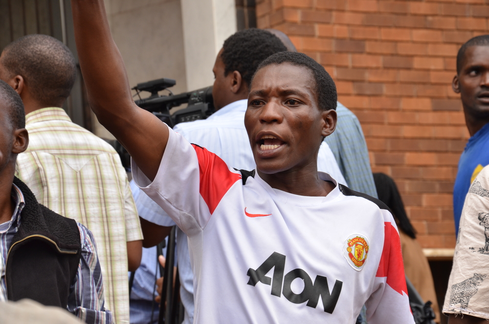 A student activist protesting, against the continued detention of a group of academics and civic society leaders of charges of treason,in front of the Harare magistrate's court in 2012