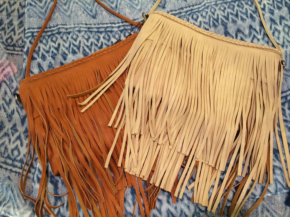 Fringe bags, available in brown, ivory and gold, $48