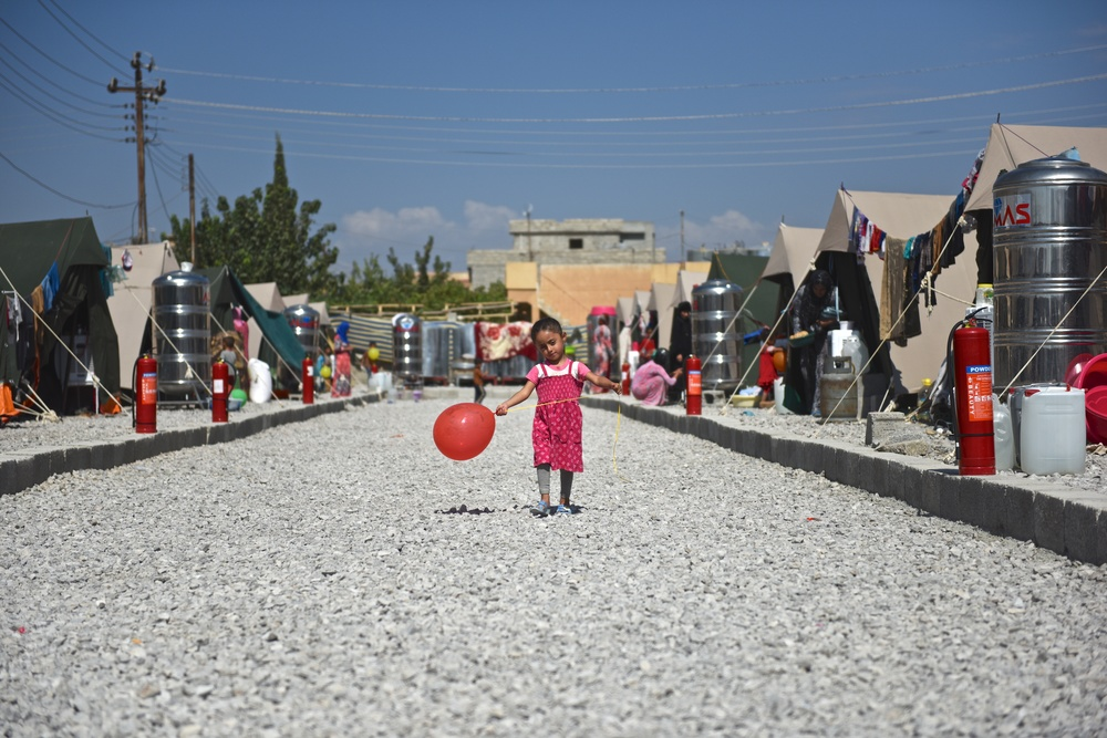 We brought balloons to this band new refugee community in Northern Iraq. They had only been there a week after they had to flee there village before ISIS took it over. Balloons were a physical representation of hope. The kids played for the first time.....kids were allowed to be kids, and it was beautiful.