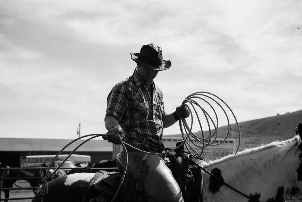 One of the family members getting his rope and horse ready for the branding.