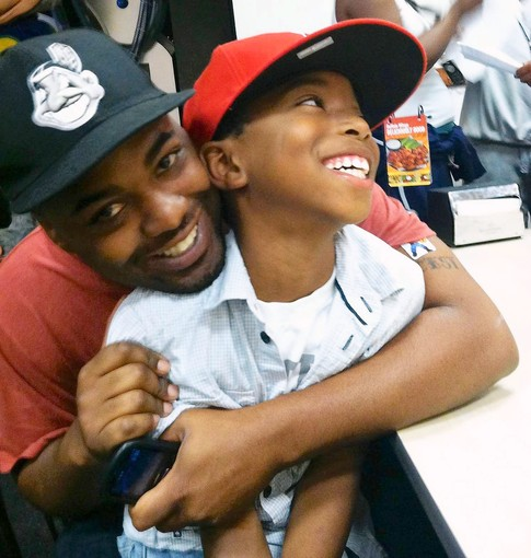 "rickehh :      latimes :      A loving Inglewood father dies shielding his son from gunfire:  Fredrick Martin Jr. made no effort to conceal his pride for his 8-year-old son. When they heard gunfire, Martin pushed the boy to the ground and huddled over him. He later died in surgery, but  his son survived .    Photo: Fredrick Martin Jr. and his 8-year-old son, Fredrick ""Tre"" Martin III.      Rest, King."