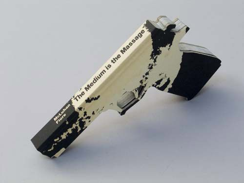 "stolenword :      Book Art     ""…carved a gun from Marshall McLuhan's  The Medium Is the Massage .""       Artist :  Robert The"