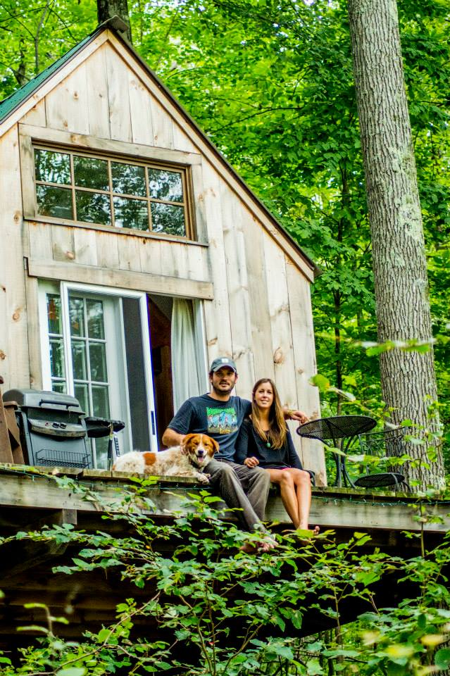 Kimberly and her husband on the deck of their tree house